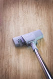 Vacuum cleaner. On the wood surface Stock Photography