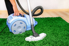 Vacuum cleaner in action Stock Images