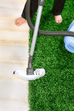 Vacuum cleaner in action  - a men cleaner a carpet.  Royalty Free Stock Image