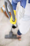 Vacuum cleaner in action Royalty Free Stock Photo