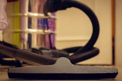 Vacuum cleaner, brush in the foreground stock photos