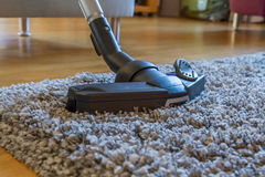 Vacuum cleaner on a carpet Stock Photos