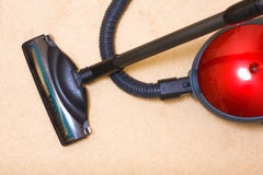 Vacuum cleaner on a carpet Royalty Free Stock Photos