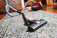 Vacuum cleaner on carpet Stock Images