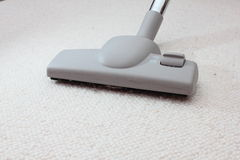 Vacuum cleaner. On carpet or floor Stock Photography