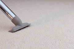 Vacuum cleaner. On carpet or floor Royalty Free Stock Photography