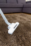 Vacuum cleaner on carpet Stock Photography