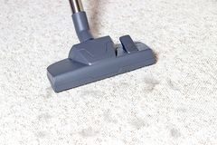Vacuum cleaner. Carpet hoover. Cleaning. Cat hair. Vacuum cleaner. Carpet hoover. Cleaning of Cat hair/ Gray color royalty free stock images