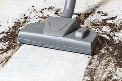 Vacuum cleaner. Carpet hoover. Cleaning. Dirty floor. Vacuum cleaner. Carpet hoover. Cleaning of Dirty floor. Gray color royalty free stock photo