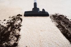 Vacuum cleaner cleaning carpet Stock Photo