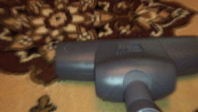 Vacuum cleaner cleaning the carpet. Pov view stock video