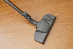 Vacuum cleaner cleans floor Stock Images