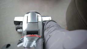 Vacuum cleaner. Commercial vacuum cleaner being run over carpet stock video footage