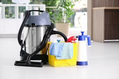 Vacuum cleaner and detergents. On floor indoors stock image