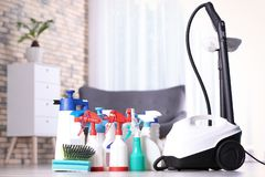 Vacuum cleaner and detergents. On floor indoors stock photography