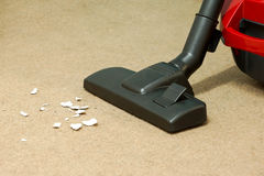 Vacuum cleaner. With dirty carpet floor Stock Images