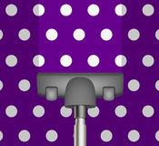 Vacuum cleaner drains purple carpet Royalty Free Stock Photo