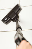 Vacuum cleaner extension tube. Sweeping housework technology device domestic concept. Vacuum cleaner extension tube. Part of hoover cleaning floor Royalty Free Stock Photography