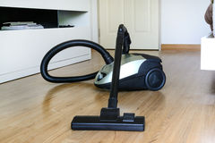 Vacuum cleaner. On the floor Stock Photography