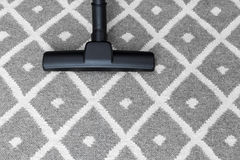 Vacuum cleaner on gray carpet. Housework. Vacuum cleaner on gray carpet royalty free stock photography