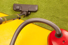 Vacuum cleaner on a green carpet. Royalty Free Stock Images