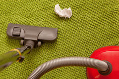 Vacuum cleaner on a green carpet. Royalty Free Stock Photo