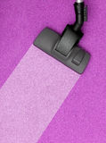 Vacuum cleaner head on pink carper Royalty Free Stock Photos