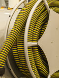 Vacuum cleaner hose. Corrugated hose wCorrugated hose is wound onto the drum circlesound on the drum Royalty Free Stock Image