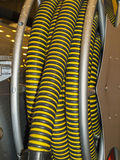 Vacuum cleaner hose. Corrugated hose wCorrugated hose is wound onto the drum circlesound on the drum stock image