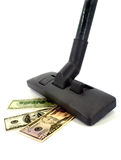 Vacuum cleaner and money Royalty Free Stock Photos