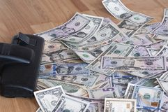 Vacuum cleaner and money. Vacuum cleaner sucks on U.S. dollars Stock Photography