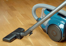 Vacuum cleaner on a oak parquet Stock Photo