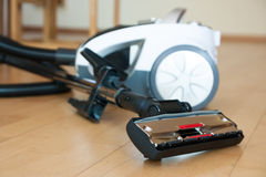 Vacuum cleaner on  parquet Stock Photography