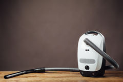 Vacuum cleaner. On parquet floor with copy-space Royalty Free Stock Image