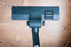 Vacuum cleaner and parquet Stock Image