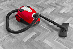 Vacuum cleaner on parquet Royalty Free Stock Image