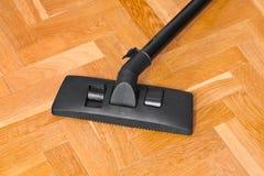 Vacuum cleaner on parquet Stock Image