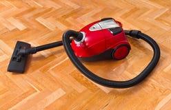 Vacuum cleaner on parquet Stock Images