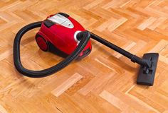 Vacuum cleaner on parquet Royalty Free Stock Photography