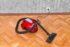 Vacuum cleaner on parquet Royalty Free Stock Photo