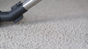 Vacuum cleaner point of view rolling back and forth. On carpet floor stock video
