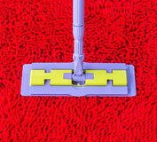 Vacuum cleaner on red carpet Royalty Free Stock Photography
