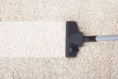 Vacuum cleaner on rug at home Royalty Free Stock Photos
