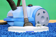 Vacuum cleaner stand  on blue carpet. Stock Images