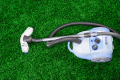 Vacuum cleaner stand  on green carpet Stock Images