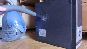 Vacuum cleaner sucks old dust on computer system unit. Stock footage stock footage
