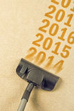 Vacuum Cleaner sweeping year number 2014 from carpet. Vacuum Cleaner sweeping year number 2014 from Brand New Carpet leaving sequence 2015, 2016... Happy New Royalty Free Stock Photos