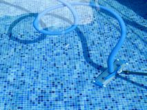 Vacuum cleaner on swimming pool. Vacuum cleaner on an outdoors swimming pool on a summer day stock photos