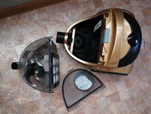 Vacuum cleaner to collect dust. No garbage bags. Details and close-up. Details and close-up stock photography