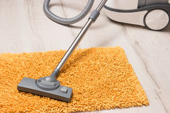 Vacuum cleaner to tidy up the living room. Stock Photography